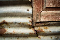 Corrosion of zinc and old window Stock Photography