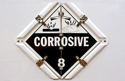 Corrosive. Hazmat placard for transportation vehicles stock photography