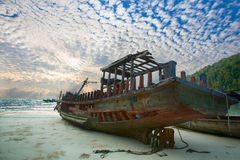 Corrosive Boat. On the beach with beautiful cloud royalty free stock images