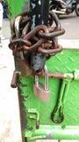 Corrosive chain and padlock at iron green gate. Photo corrosive chain and padlock at iron green gate royalty free stock image