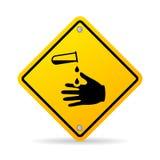 Corrosive chemicals danger warning sign Stock Images