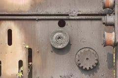 Corrosive gear on the board. Corrsive gear on the board under the sun in the trash Stock Image