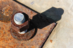 Corrosive rusted bolt with nut. Grunge industrial construction royalty free stock photo