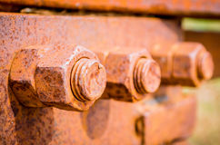 Corrosive rusted bolt with nut. Grunge industrial construction close up. Stock Photos