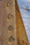 Corrosive rusted bolt with nut. industrial construction close up. Royalty Free Stock Photography