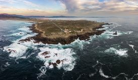 Corrubedo cape and lighthouse. Photography made with a drone The cape of Corrubedo, located in the region of Barbanza in the city of Santa Uxia de Riveira Royalty Free Stock Image
