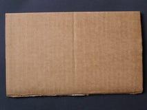 Corrugated cardboard. Brown corrugated cardboard sheet useful as a background Stock Photo