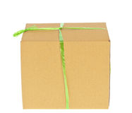 Corrugated cardboard box with green rope Stock Images