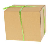Corrugated cardboard box with green rope Royalty Free Stock Photo