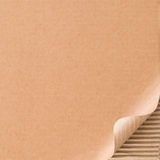 Corrugated cardboard with curled corner Stock Photo