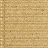 Corrugated cardboard goffer paper texture, bright rough old recycled goffered crimped textured blank empty grunge copy space. Background, large aged detailed Royalty Free Stock Photos