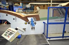 Corrugated cardboard production line. View of corrugated cardboard production line at the plant royalty free stock photo
