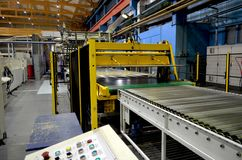 Corrugated cardboard production line. View of corrugated cardboard production line at the plant stock photography