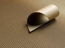 Corrugated cardboard roll. Abstract close up made by cardboard asymetric roll on corrugated backround. Natural paper color stock photo