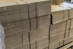 Corrugated cardboard sheets in piles royalty free stock images