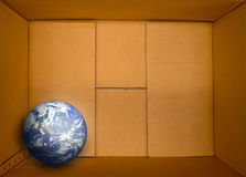 Corrugated carton and the earth inside Royalty Free Stock Photos