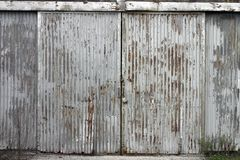 Corrugated door at abandoned factory building Stock Image