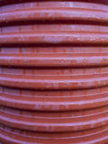 Corrugated drainage pipe made of plastic. Close up view Royalty Free Stock Image