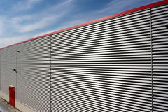 Corrugated facade. Sky and corrugated facade of warehouse royalty free stock photos