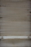 Corrugated fence. Old corrugated iron fence with locks Stock Image