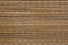 Corrugated or fluted texture of brown yellow color. For abstract tone or for wallpaper Stock Photo