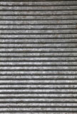 Corrugated goffered metal background texture. Corrugated goffered gray galvanized metal sheet background texture washboard, skiffle board Stock Photo