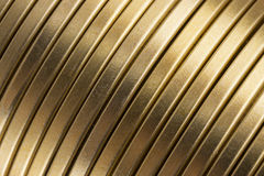 Corrugated gold metal texture. Corrugated or ribbed gold metal texture or background stock photography