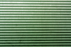 Corrugated green metal plate surface. Stock Image