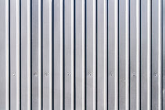 Corrugated grey fence steel siding background. Texture Royalty Free Stock Photos