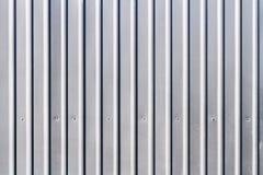 Corrugated grey fence steel siding background Royalty Free Stock Photos