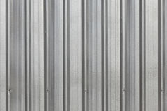 The corrugated grey metal wall background. Royalty Free Stock Photos