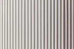 The corrugated grey metal wall background. Royalty Free Stock Photography