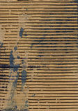 Corrugated grunge texture. Scanned image of torn cardboard background texture, with some ink stains Royalty Free Stock Photo