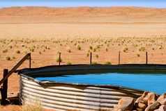 Corrugated iron dam on desert farm Royalty Free Stock Image