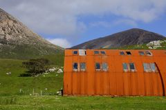 Corrugated iron house on the Isle of Skye. Rusty corrugated iron house on the Isle of Skye Royalty Free Stock Photos