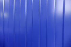 Corrugated iron is new. The texture of the tree. Background blue. Royalty Free Stock Photo