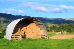 Semicircular metal barn full of hay royalty free stock photo