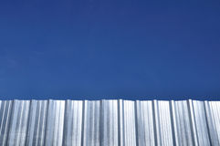 Corrugated iron sheet with blue sky Royalty Free Stock Images