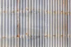 Corrugated Iron Siding. Rusted, galvanized, corrugated iron siding, vintage background Stock Photos