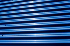 Corrugated iron structure. In blue tonal color Royalty Free Stock Photography