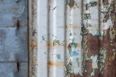 Corrugated iron surface is covered with old paint, chipped paint, texture background Stock Photo