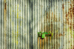 Corrugated iron wall. Contrasty colourful scene with corrugated iron wall and heavy padlock Stock Images