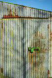 Corrugated iron wall. Contrasty colourful scene with corrugated iron wall and heavy padlock Stock Photography