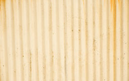 Corrugated iron wall with peeling paint. Royalty Free Stock Photography