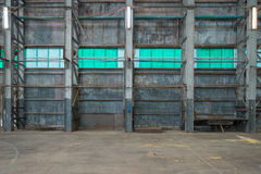 Corrugated iron wall in a warehouse Royalty Free Stock Images