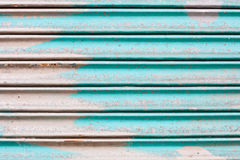 Corrugated metal. Blue rusty corrugated metal sheet as a background Stock Image