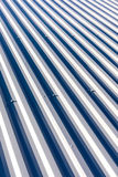 Corrugated metal with bolts for roofing on industrial buildings Stock Photo