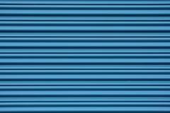 Corrugated metal door. Corrugated metal sheet door in blue royalty free stock photos
