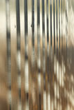 Corrugated metal fence with zinc coating Stock Photo