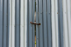 Corrugated metal gate padlocked Royalty Free Stock Image